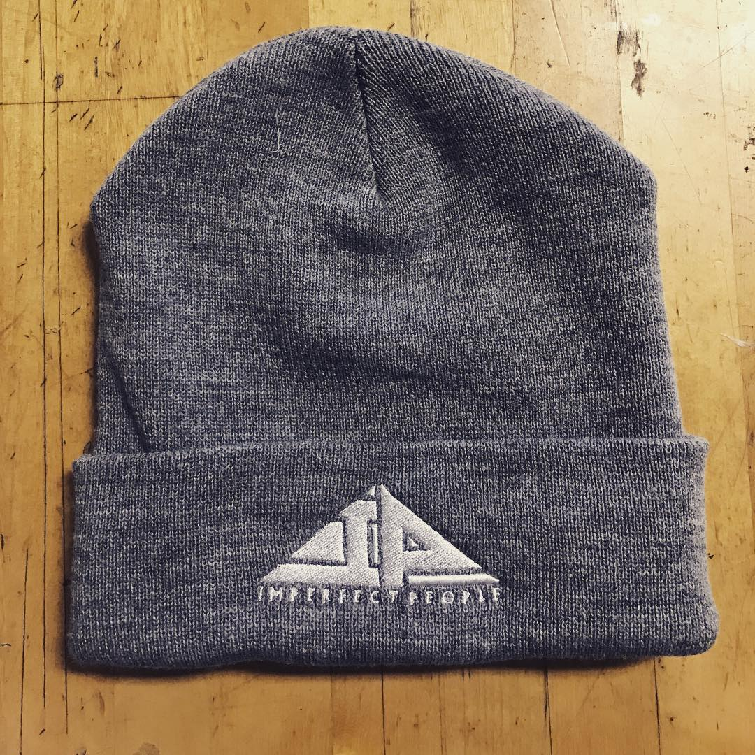 custom beanie on wood background